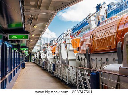 Orange Lifeboats Alongside Deck On Cruise Ship