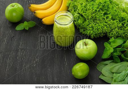 Green Homemade Smoothies On Black Background. Copy-space Composition. Selective Focus. Healthy Food,
