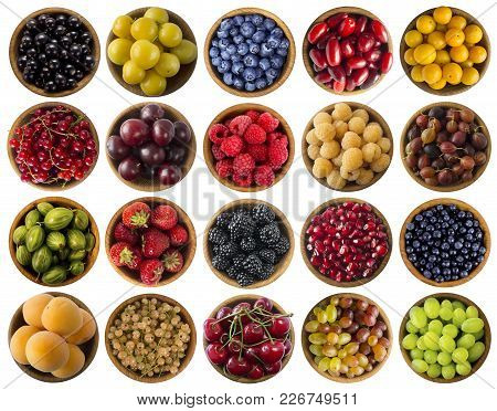 Berries Isolated On White. Collage Of Different Colors Fruits And Berries. Fruits And Berries In Bow