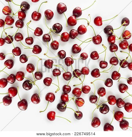 Fresh Red Cherries Lay On White Isolated Background With Copy Space. Background Of Cherries. Ripe Ch