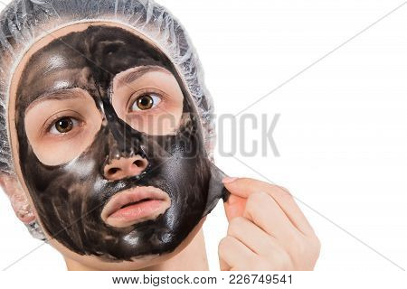 Theme Of Beauty And Skin Care. Girl With Peel-off Mask On Face Isolated On White Background.