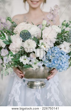 Beautiful Floral Composition In Silver Bowl In Hands Young Smiling Bride.