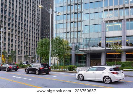 TOKYO, JAPAN - NOVEMBER 14, 2016: Streets of Tokyo city, capital of Japan. Tokyo Metropolis is both the capital and most populous city of Japan.