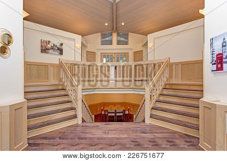 Luxury Home Interior With Double Sided Staircase