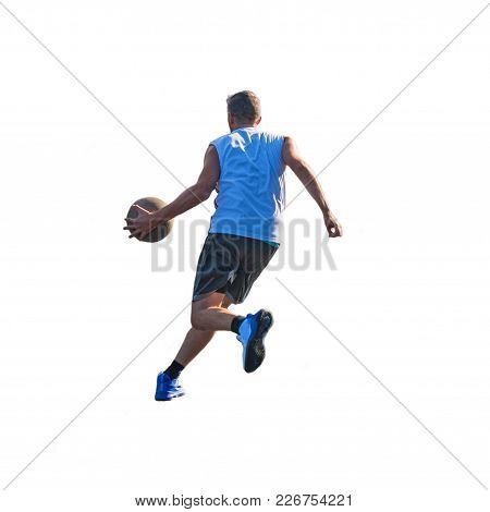 Basketball Player Dribbling To The Basket Seen From Behind