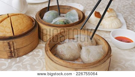 Having chinese dim sum in restaurant together