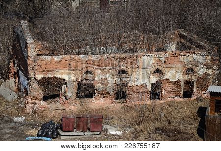 Ruins Of An Old Destroyed Brick Building In The Courtyard Of The Znamensky Monastery In Irkutsk. Top