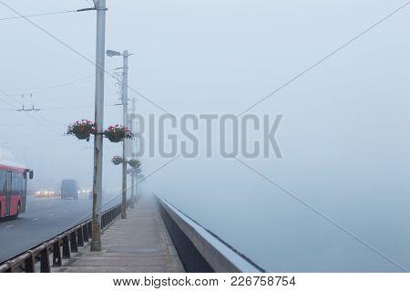 Dense Fog Over Bridge Autumn Morning In The City