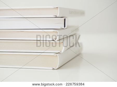 Pile Of White Books On White Table Close Up View