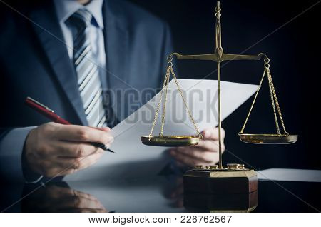 Lawyer Or Attorney Works In His Office
