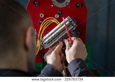 Electrician Works With Hands Of Electric - Wires And Equipment