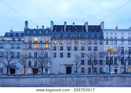 Facades Of Apartment Buildings On Ile Saint Louis, Paris, France