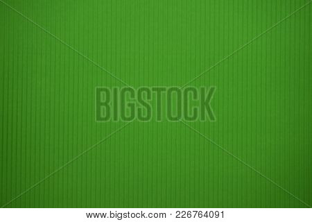 Light Green Colored Corrugated Cardboard Texture Useful As A Background