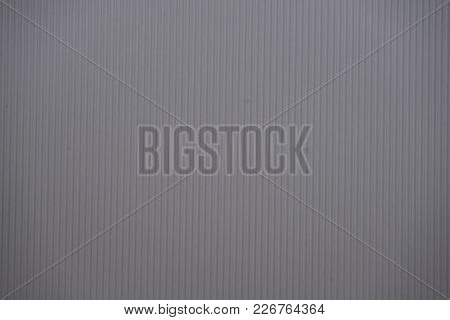 Grey Colored Corrugated Cardboard Texture Useful As A Background