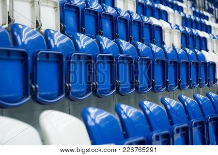 Dark Blue Metal Empty Seats In Concert Or Hockey Stadium, Row Of Seats In Sport Stadium.