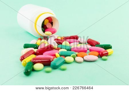 Spilled Pills Or Tablets Out Of A Bottle