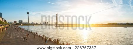 Panormaic View Of Dusseldorf City At The Rhine Shore At Sunset. Ideal For Websites And Magazines Lay