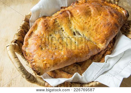 Scrumptious Home Baked Italian Pastry Calzone With Sweet Apple Pie Raisins Cinnamon Filling In Wicke
