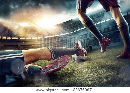 The Legs Of Soccer Football Players On Green Field Of The Stadium. Advertising Concept Of Soccer Foo
