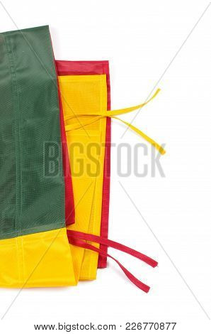 The Folded Flag Of Lithuania : Green, Yellow, Red