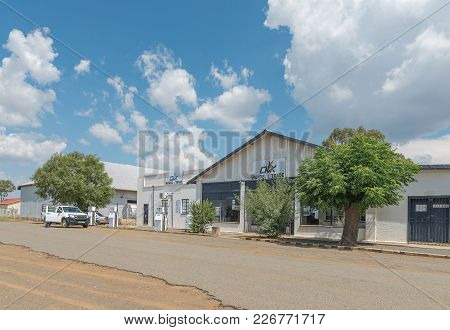 Verkeerdevlei, South Africa, February 9, 2018: A Street Scene With An Agricultural Retailer And Gas