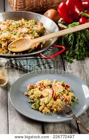 Traditional Seafood Paella With Shrimp, Fish And Chicken Seved In Plate.