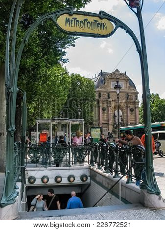 Paris, France - May 29, 2006: Metropolitain Entrance To Saint Michel Subway Station Against St. Mich