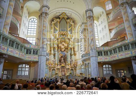 Dresden, Germany - May 18, 2010: Unidentified People Visit Famous Frauenkirche Cathedral In Dresden,
