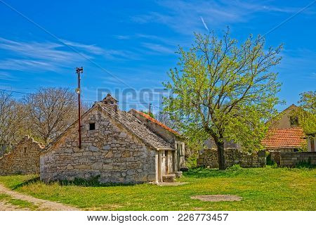 Pakovo Selo, Croatia - April 15, 2016 An Old Stone Family House Typical For Dalmatian Zagora.