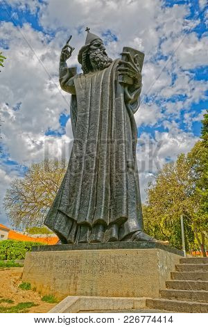 Split, Croatia - April 15 2016: The 8.5 Metre Tall Statue Of Gregory Of Nin By Ivan Mestrovic.