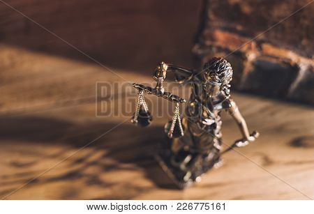 The Statue Of Justice - Lady Justice Or Iustitia / Justitia The Roman Goddess Of Justice On A Wooden