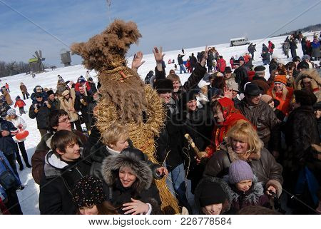 Maslenitsa Scarecrow Surrounded By People