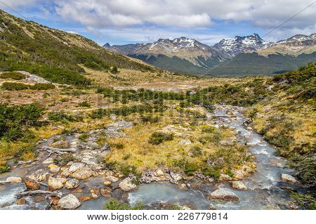 Stream In Laguna Esmeralda Trail With  Mountains And Vegetation