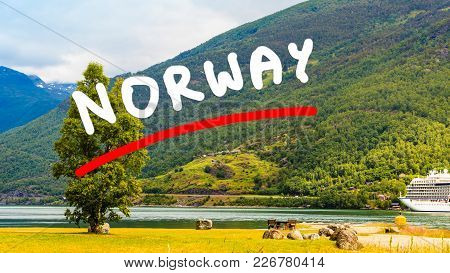 Tourism Vacation And Travel. Mountains Landscape And Big Cruise Ship On Fjord Sognefjord In Flam Nor