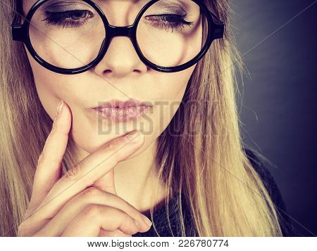 Intellectual Expressions, Being Focused Concept. Closeup Of Attractive Woman Wearing Big Eyeglasses
