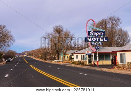 Seligman, Arizona, Usa - January 2, 2018 : Supai Motel Neon Sign  And Building Located Directly On H