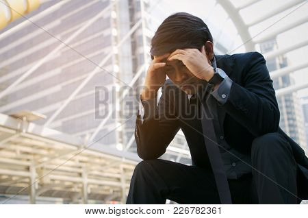 Disappointed, Sadness Or Stressed Medium Aged Unemployed Asian Business Man Sitting On The Walkway I