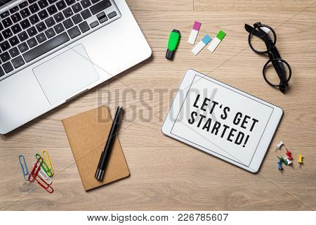 Let's Get Started Written On Tablet Lying On Desk As Flatlay