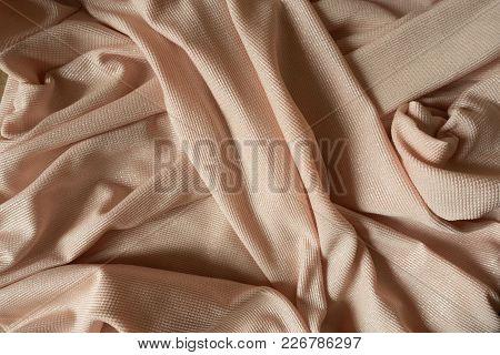 Folded Beige Polyester Textile With Sparkling Fiber