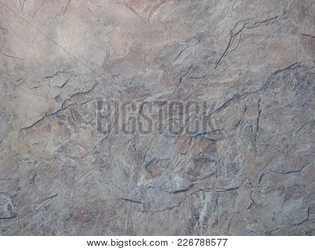 Texture, Background. The Pavement Of Granite Stone. Paved Roadway Street. Any Paved Area Or Surface.