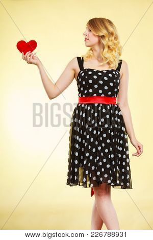 Woman Blonde Cute Girl Wearing Dotted Dress Holding Red Heart Love Symbol Studio Shot On Bright. Val