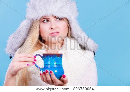 Accessories And Clothes For Cold Days, Fashion Concept. Blonde Woman In Winter Warm Furry Hat Drinki
