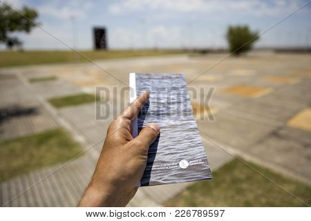 Buenos Aires, Argentina - January 22, 2018: Male Hand With Ticket Of Remembrance Park In Buenos Aire