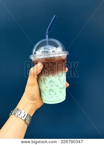 Hand Hold Mint Water And Chocolate Water In Plastic Glass On Navy Blue Background, Fresh Mint.