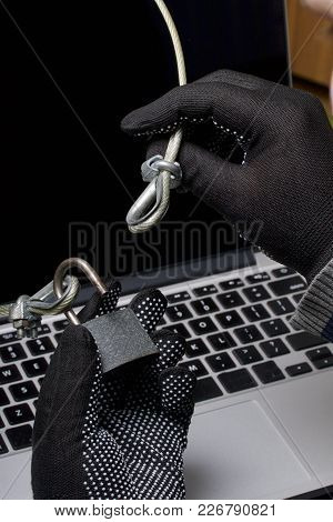 Computer Security. Protection Of Access To Data. The Laptop Is Protected By A Security Cable And A L