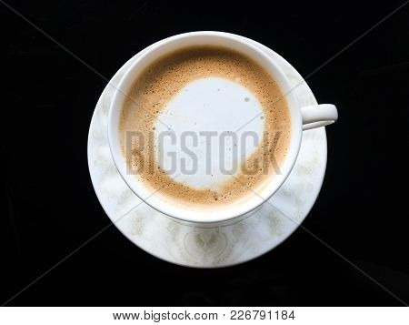 Top View Tasty Hot Cappuccino Coffee With Heart Art Milk Foam On Top And Coffee Beans On Wooden Tabl
