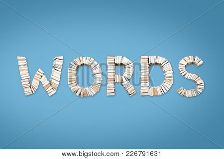 WORDS word formed from books, shot from above on light blue background