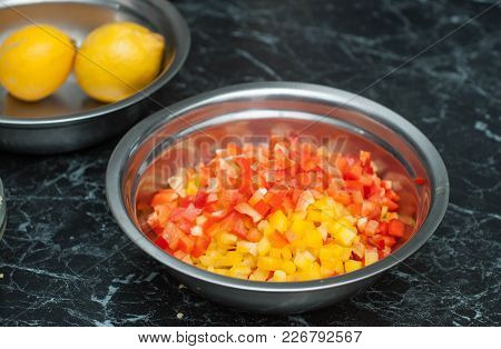 Chopped Bell Peppers In A Metal Bowl. Food Preparing Process At The Restaurant Kitchen.