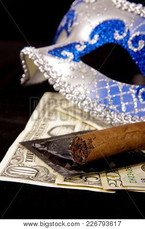 Prostitution Concept Which Is Reflected In Photo By Using  A Luxury Cigar, Money, Condoms And Seduct