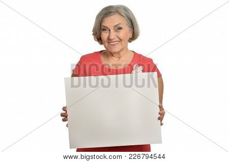 Portrait Of An Elderly Woman In A Pink Dress With Blank Card Isolated On A White Background